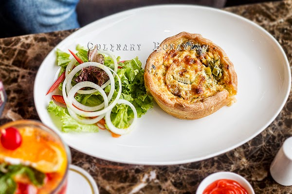 Gardener Quiche - sauteed leek with onions and cheese, milk, heavy cream, eggs, salt, pepper & nutmeg