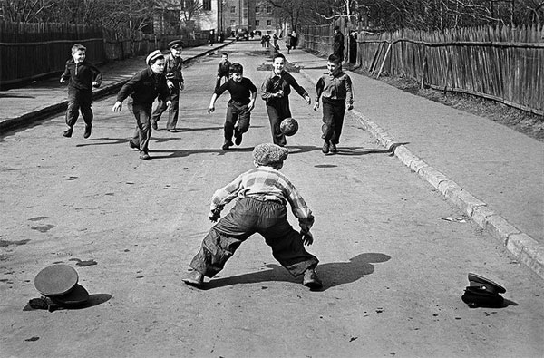 boys-playing-football-in-the-street