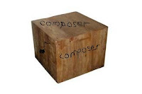 "A wooden block with ""Composer"" written"