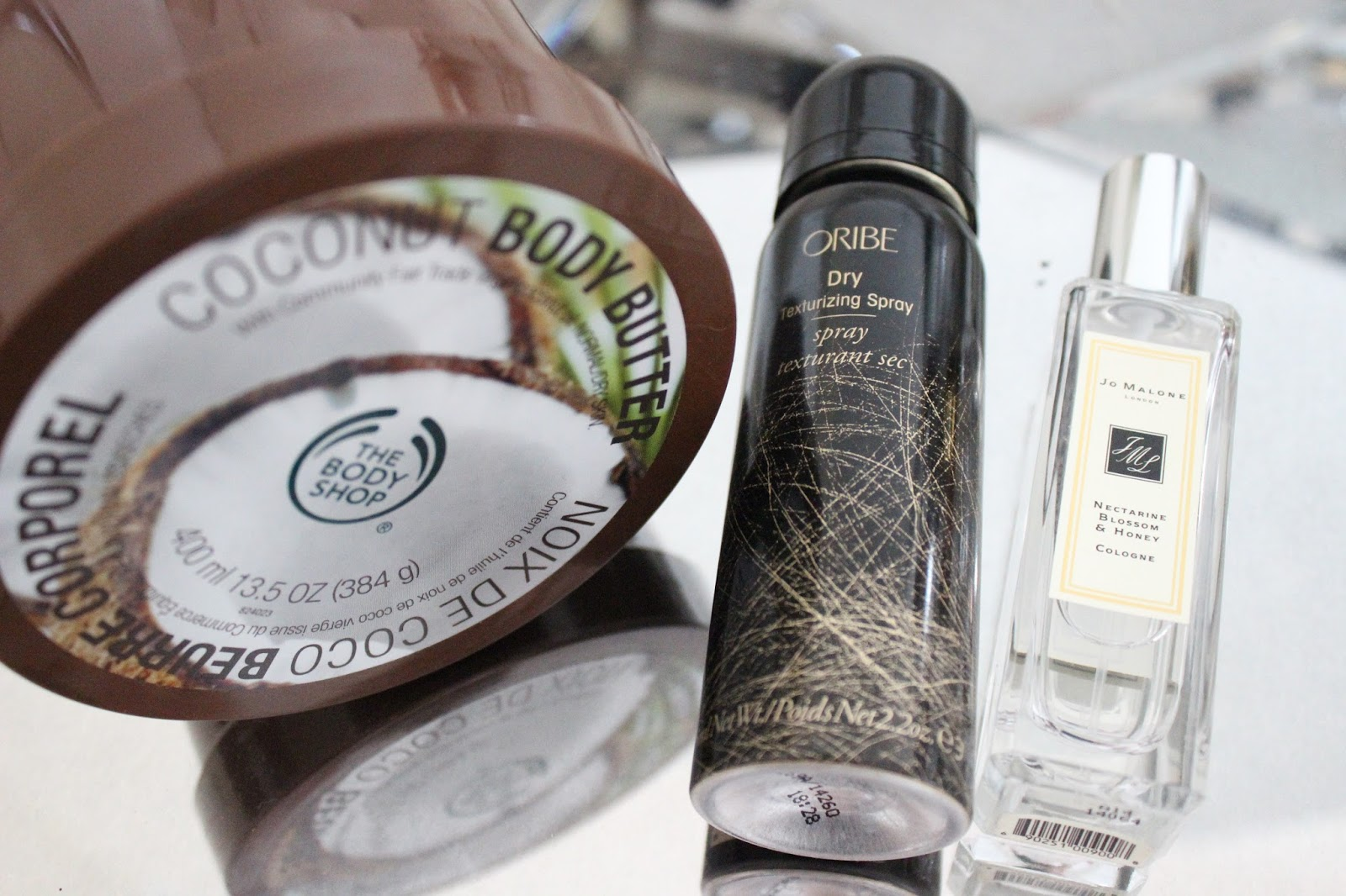14 Top Beauty Favourites from 2014 - Body Shop Coconut Body Butter, Oribe Dry Texturising Spray, Jo Malone Nectarine Blossom & Honey Cologne