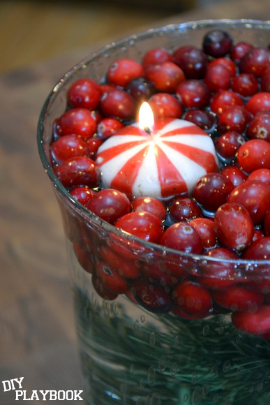 Place a candle to float among the cranberries on top.