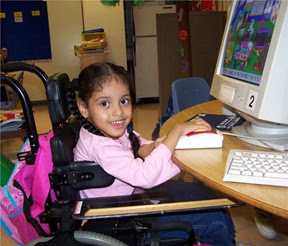 Young girl with disability using a computer
