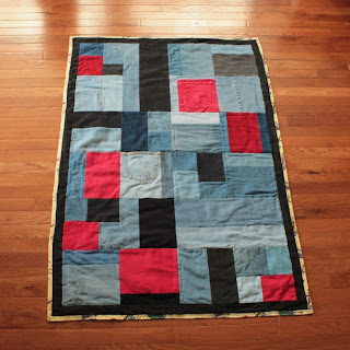 denim baby quilt in red black and blue