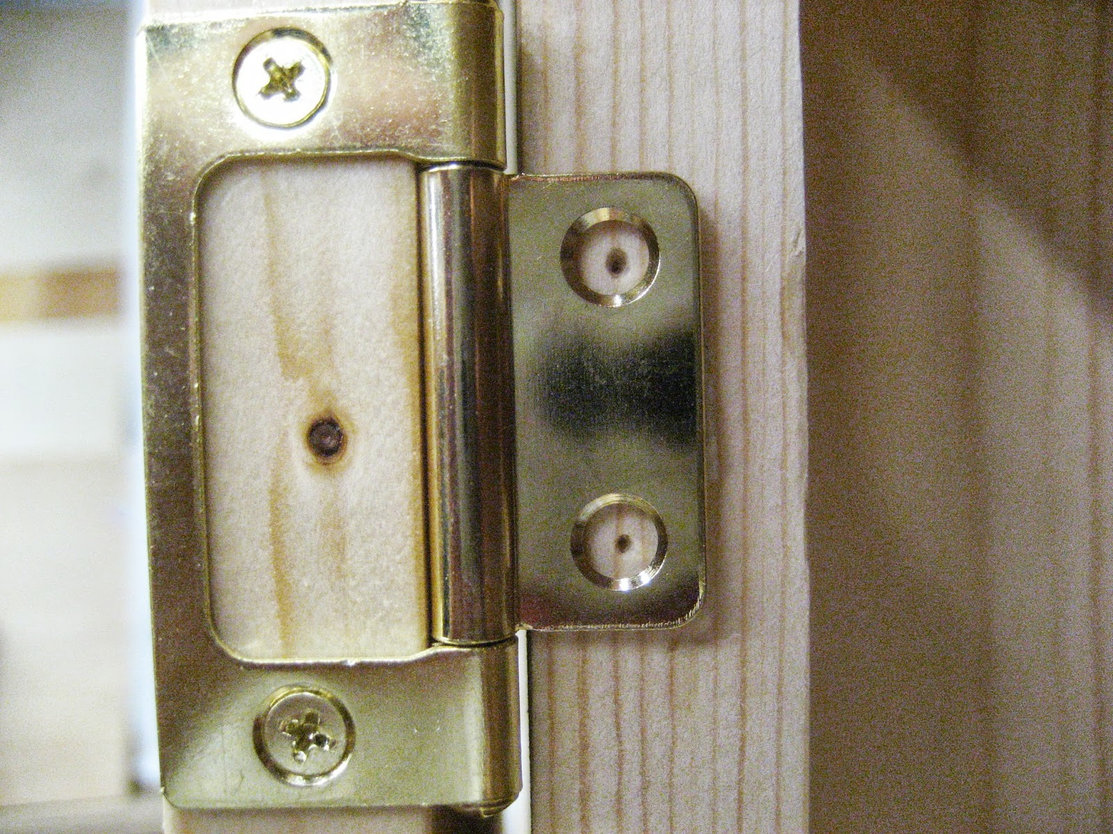remove tape clamp door to face frame with scrap that is the same thickness as hinge barrel drill pilot holes and secure door