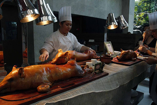 Lechon stuffed with Truffle Rice and Lechon stuffed with Sisig Rice