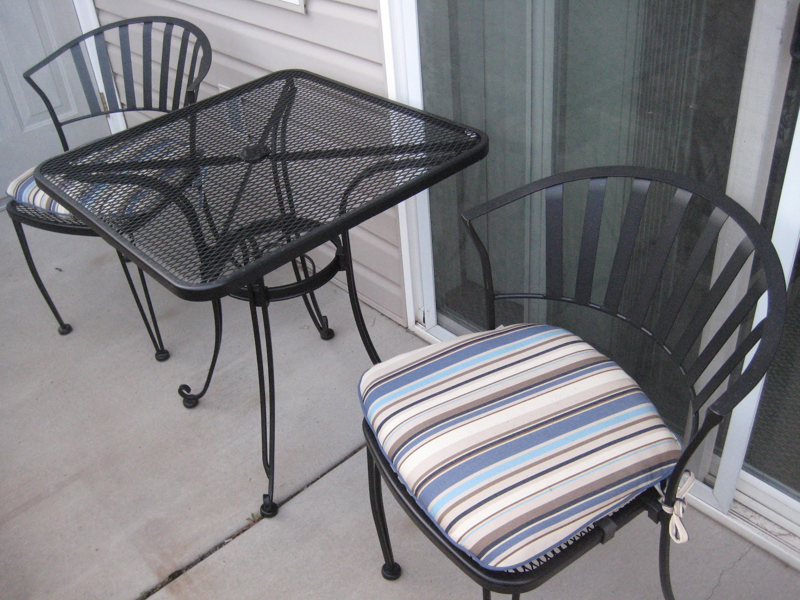 Wrought iron patio chairs costco type for Wrought iron furniture