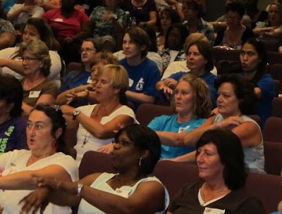 photo of: Teachers at conference presentation on the value of music in early childhood