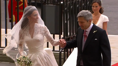 Catherine holds her father's hand followed by her sister Pippa. YouTube 2011.