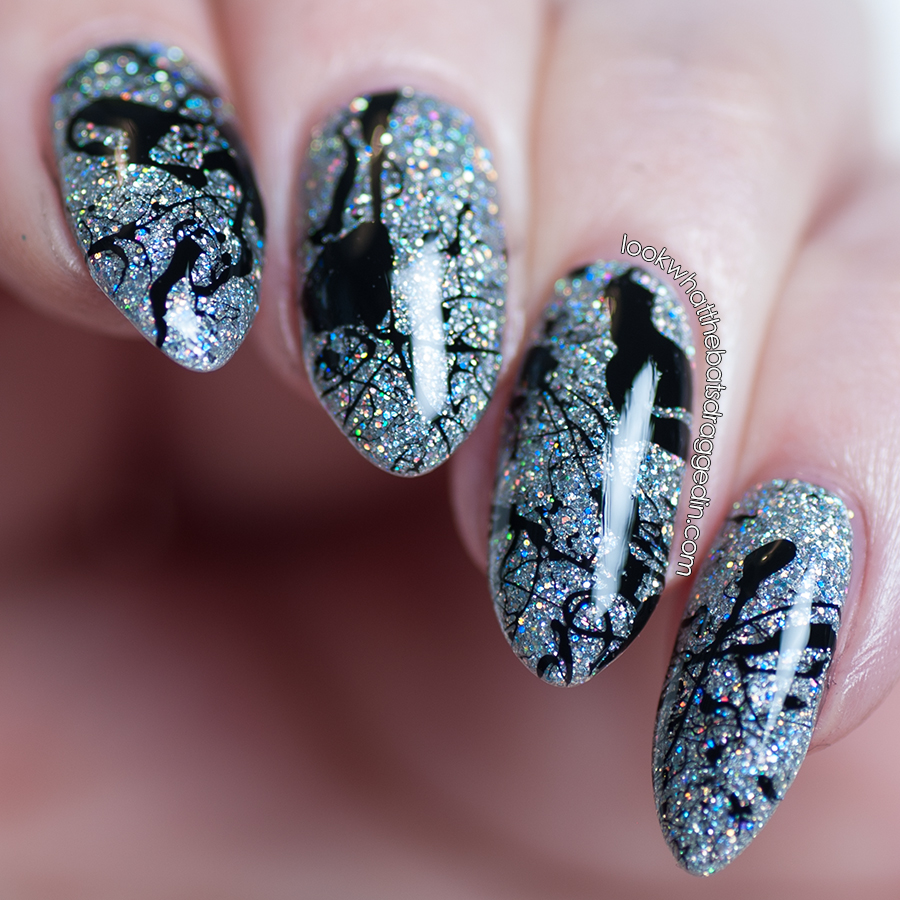 Holographic splatter nail art done with Loki's Lacquer