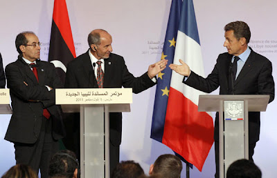 "France's President Nicolas Sarkozy (R), Mustafa Abdel Jalil (C), chairman of the Libyan National Transitional Council (NTC), and Mahmoud Jibril (L), the head of NATO's rpuppet National Transitional Council, hold a joint news conference at the ""Friends of Libya"" conference at the Elysee Palace in Paris, Sept 1, 2011. [Agencies]"