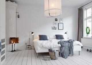 cozy scandinavian bedrooms 4 554x397 Dekorasi kamar tidur untuk cuaca dingin