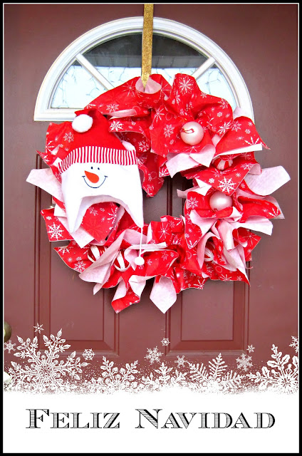 DIY Snowman Christmas Paper Napkin Wreath, wish your guests a Happy Holidays with this Winter paper napkin wreath! Put together in only a few minutes it lasts all season long bringing cheer to all!