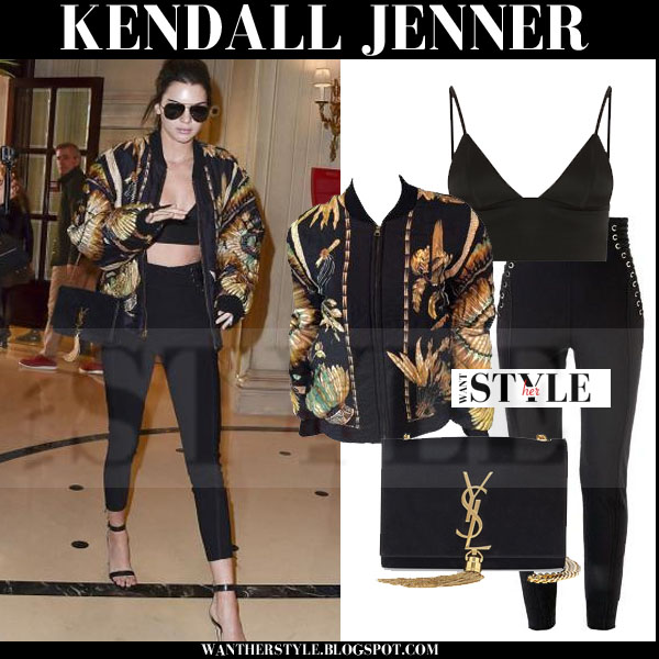 Kendall Jenner in black printed bomber Hermes Vintage jacket, black bralette Alexander Wang top and black high rise pants what she wore models off duty