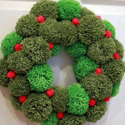 http://wipkits.blogspot.com/2011/12/pom-pom-wreath.html