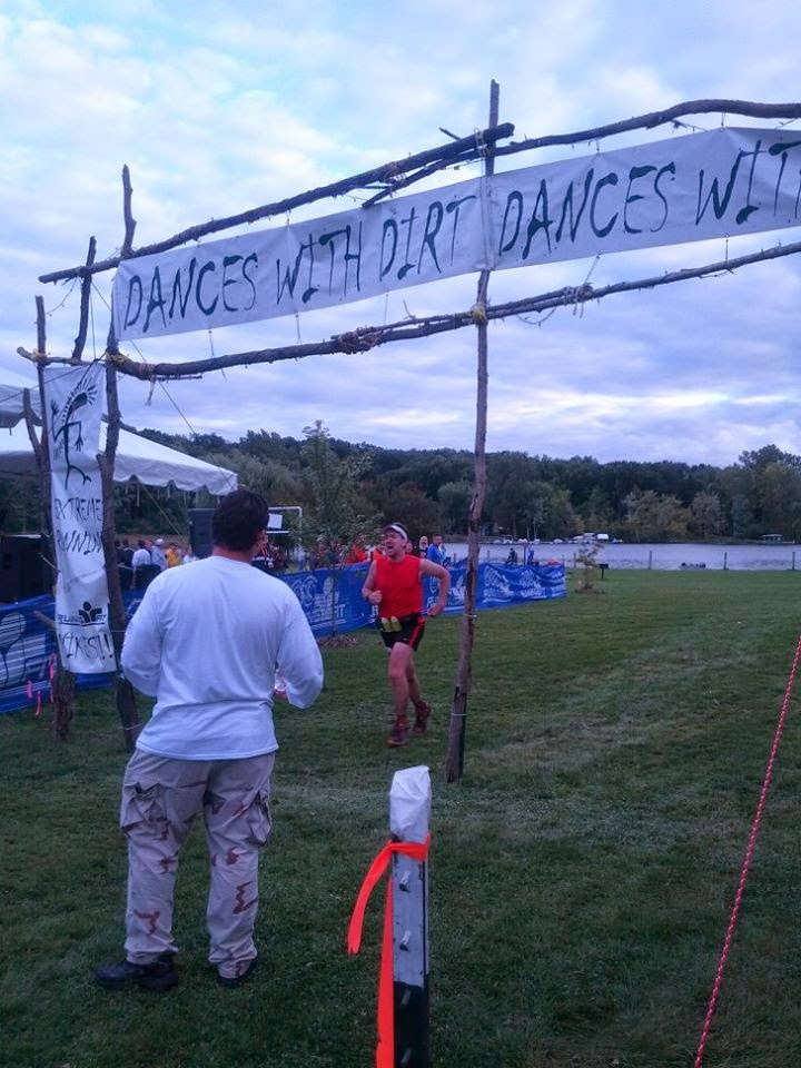 Charging through the finish chute with pain and pride after 50 miles with Glass
