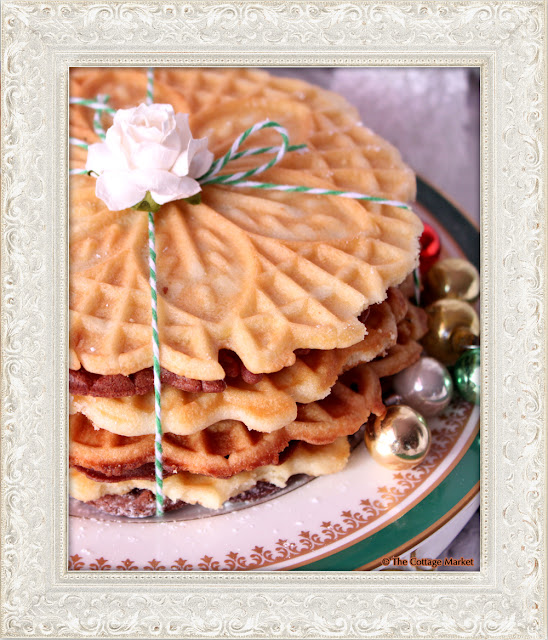 These homemade pizzelles bunched together with string and a flower are festive.