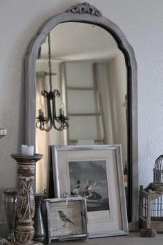 espejo con marco de madera policromado