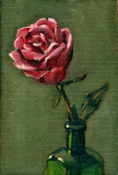 Oil painting of an opened pink rose blossom protruding from the next of an antique green bottle.