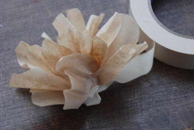 Finish your flower and secure the end of the masking tape.