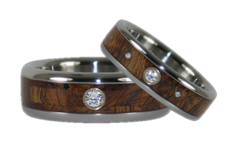 http://www.titaniumringshop.com/diamond-titanium-ring-set-with-tiger-wood-inlays-p-847.html