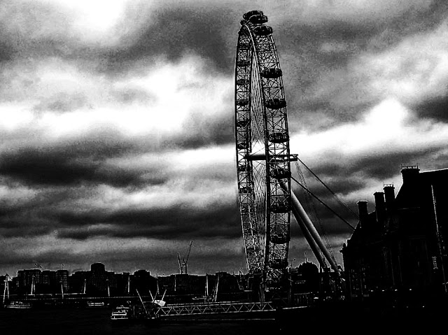 black and white silhouette of the giant ferris wheel called London Eye