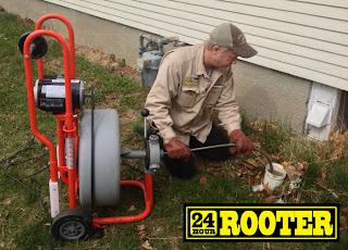 Plumbers in Yakima WA using a drain cleaning machine