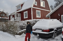 Wintertime - Nils in front of the house