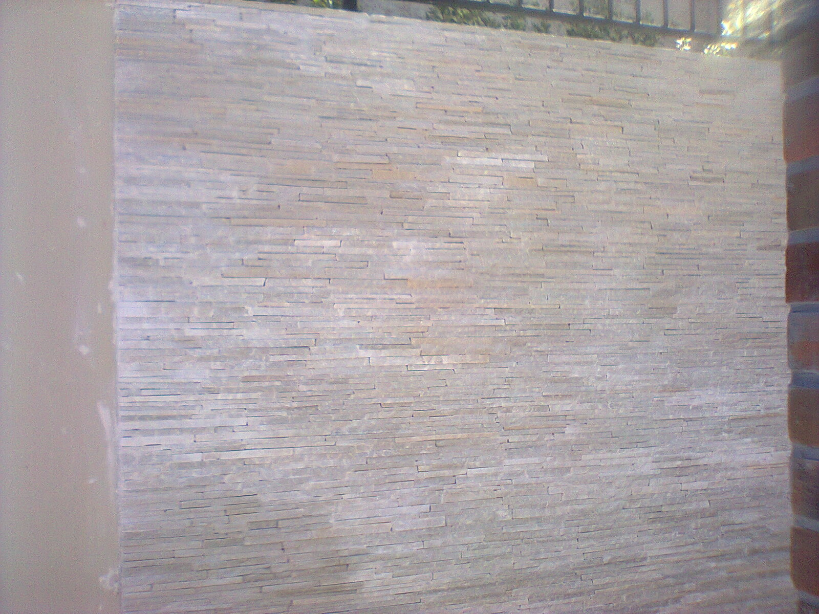 Paredes decoradas com pedras decorativas for Placas decoradas para pared