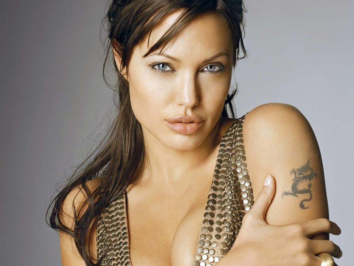 http://2.bp.blogspot.com/-l36LrvtVsKs/TmN8hQVG8HI/AAAAAAAAAR0/howbsecybSM/s1600/angelina-jolie-tiger-tattoos.jpg