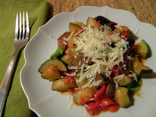 Plate of Ratatouille with grated cheese
