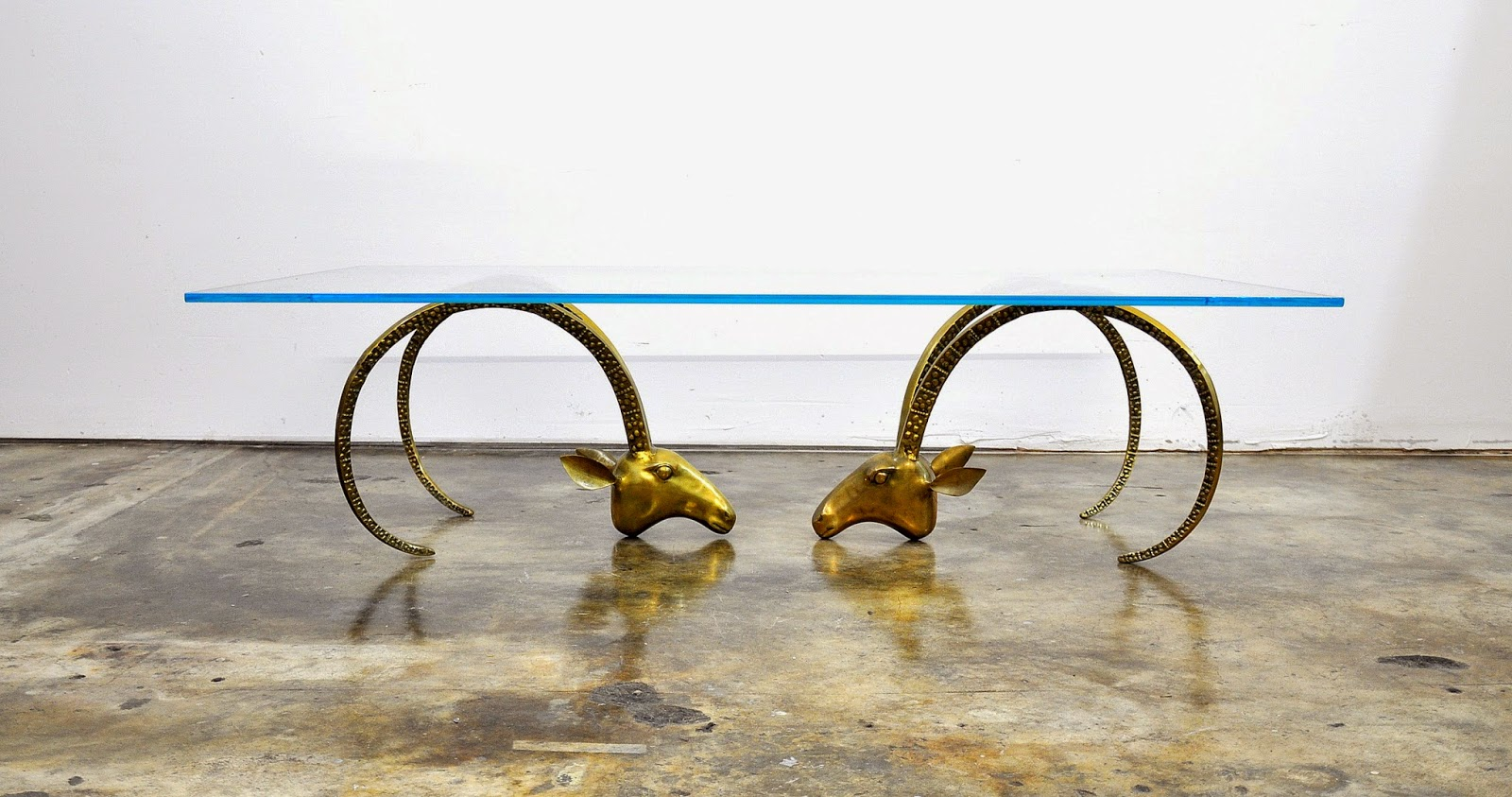 select modern chervet style ibex heads hollywood regency brass