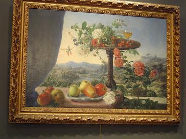 O/L Firmado Murillo Bracho,Jose Maria, Bodegon con velador frutas flores en una legania