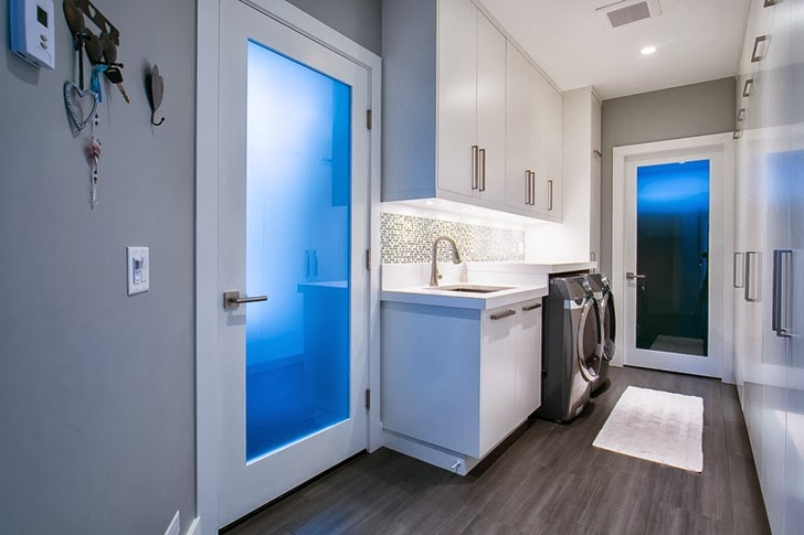 Laundry room in Contemporary home by Trevor Euley in Canada