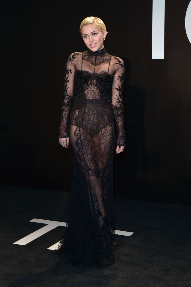 Miley Cyrus stuns in a sheer lace gown at the Tom Ford Fall/Winter 2015 Fashion Show in LA