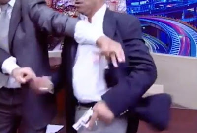 Jordanian parliment member pulls gun on critic on live tv