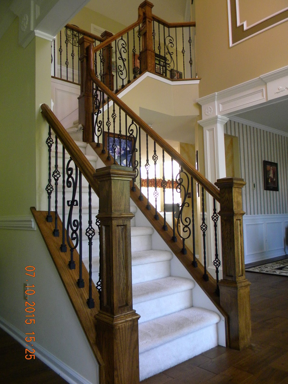 Wood stairs and rails iron balusters