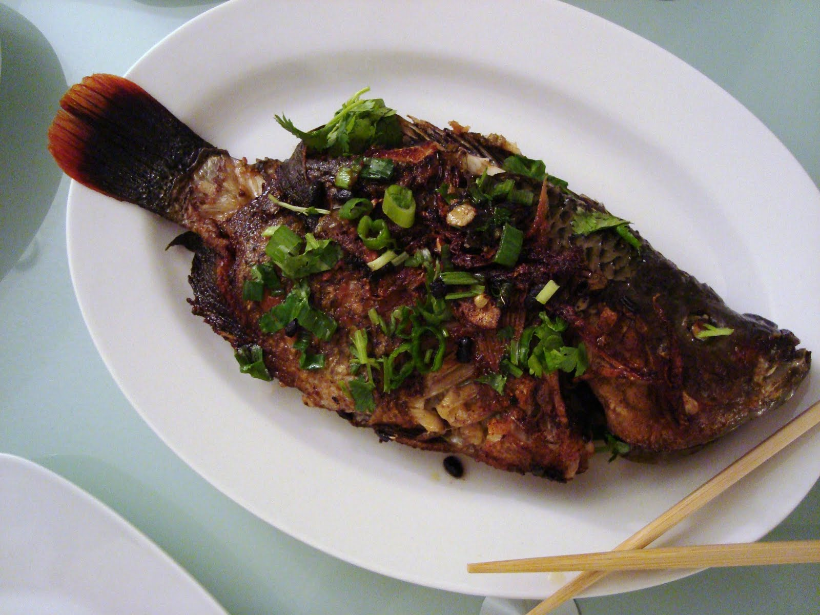Pan fried whole tilapia for Fried tilapia fish