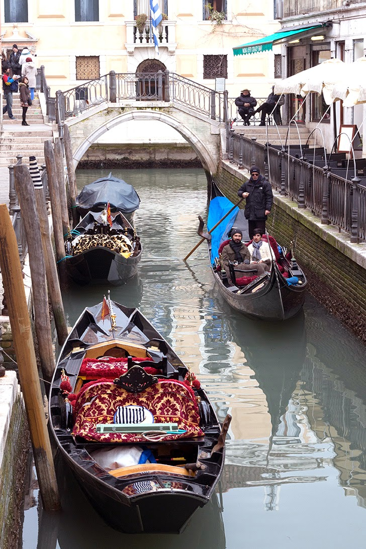 riding gondola in a quite Venetian canal