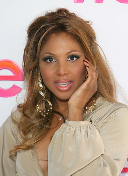 Toni Braxton wearing a pair of Jenny Dayco earrings