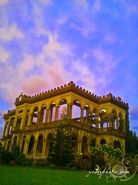 hover_share Golden color of The Ruins against the colorful sky.