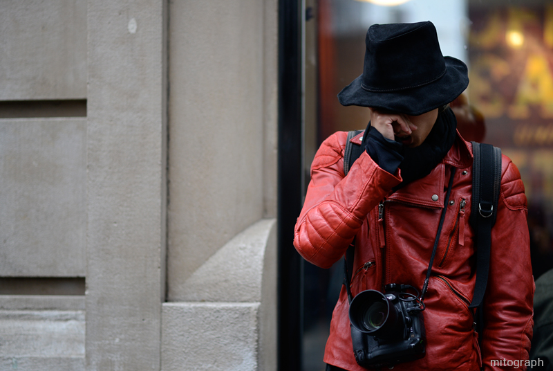 Street Style Photographer YoungJun Koo is rubbing his eye on the street of New York.