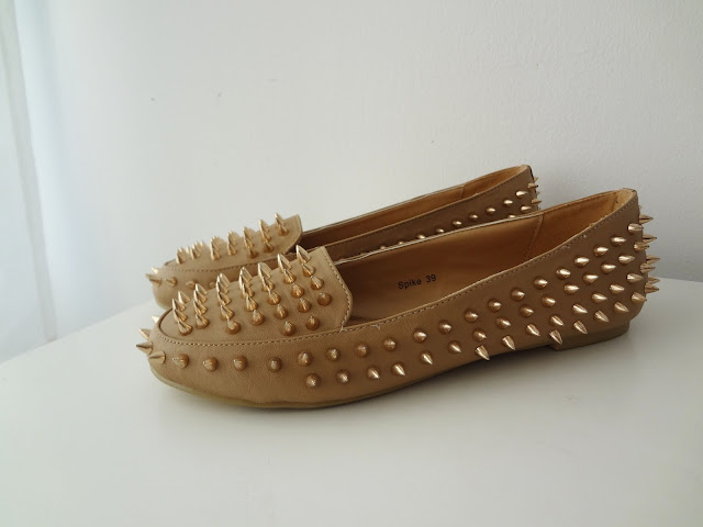 NLY Trend Spike loafers in the color taupe with gold spikes.