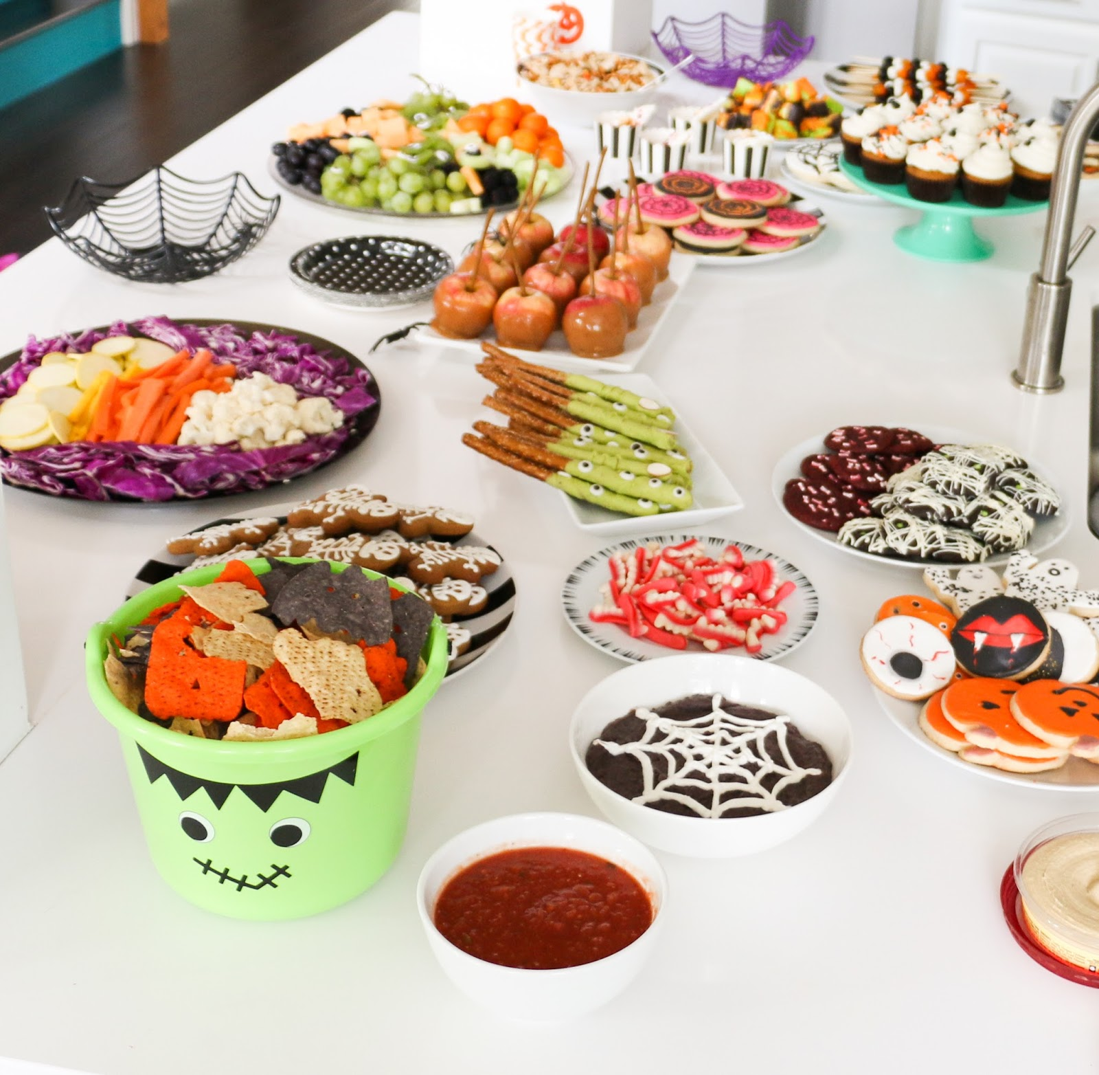 fruit and veggie trays halloween antipasto skewers chips salsa guacamole and black bean dip with piped sour cream web