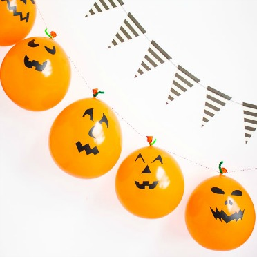 Turn balloons into jack-o-lanterns