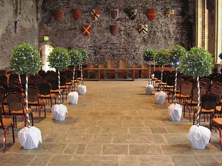 wedding aisle lined with bay trees