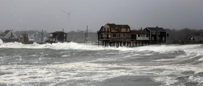 Wind turbine behind Sandy storm surge