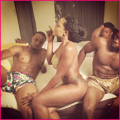 Maheeda Pose with 3 guys on bed