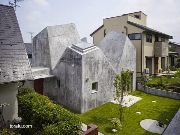 Casa contemporánea de concreto estilo Minimalista de techos únicos