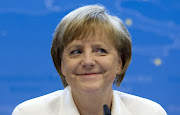 German Chancellor Angela Merkel smiles during a media conference at an EU .