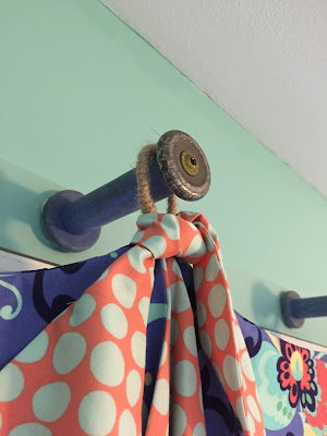 Antique spools used for hanging my craft rooms' valances.